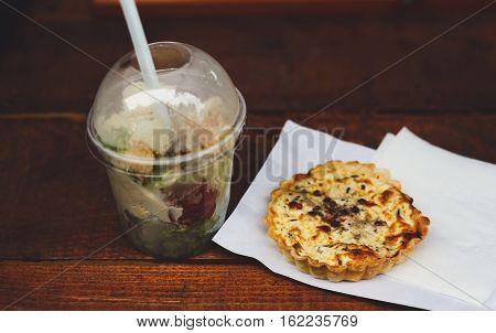 Street fast food, meat tart and salad. Bistro meals, beef and mushroom pie closeup
