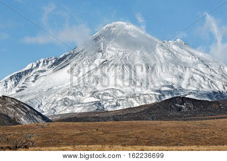 Volcanic landscape on Kamchatka Peninsula: view on active Bezymianny Volcano(Bezymiannaya Sopka). Eurasia Russian Far East Kamchatka Region Klyuchevskaya Group of Volcanoes.