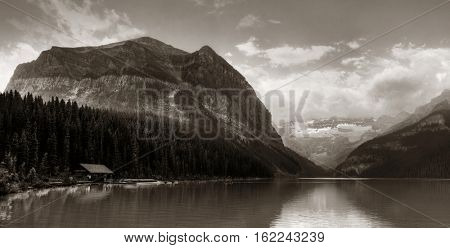 Banff national park Lake Louise sunrise panorama with mountains and forest in Canada.
