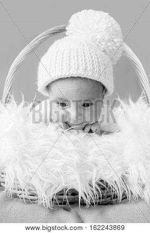 cute newborn baby in knitted cap ( black and white )