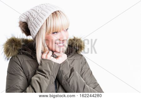 Portrait Of Smiling Woman With Jacket And Hat
