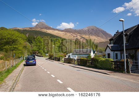 Glencoe Village in Glen Coe Lochaber Scottish Highlands Scotland UK blue sky in summer