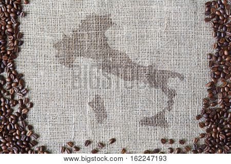 Burlap texture with coffee beans border. Sack cloth background with Italy map spot in the middle. Brown natural sackcloth canvas. Seeds at hessian textile