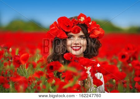 Beautiful Happy Smiling Teen Girl Portrait With Red Flowers On Head Enjoying In Poppies Field Nature