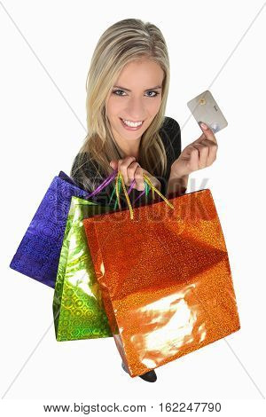 Shopping woman with colorful bags and credit card