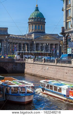 Saint Petersburg, Russia - July 26, 2014:  Tour Boats On The Moika River And The Kazan Cathedral
