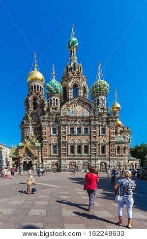Saint Petersburg, Russia - July 26, 2014:  Tourists Walk In Front Of The Church Of The Savior