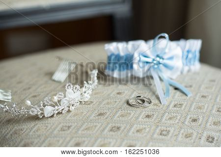 wedding details garter rings crown, lie on a chair