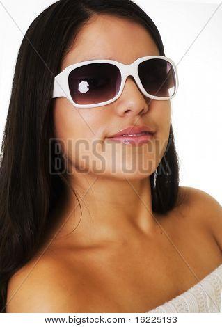 Beautiful young woman wearing white sunglasses