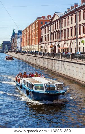 Saint Petersburg, Russia - July 26, 2014:  A Tour Boat With Tourists On The Moika