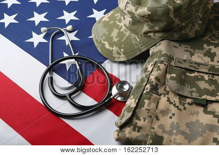 Stethoscope and military uniform on American national flag