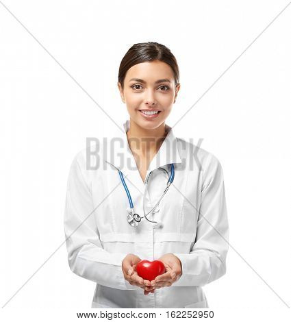 Young female cardiologist holding plastic heart isolated on white