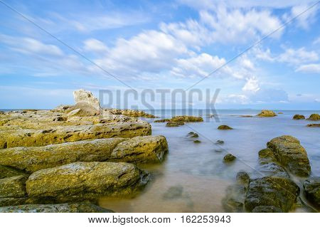 A view of beautiful Tanjung Kubong tropical beach with rocks formation located at the northern tip of Labuan Island. It is also the place where the famous and mysterious chimney standing high.