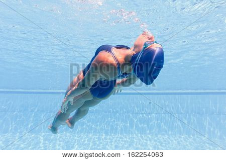 Underwater image of a woman, toned image underwater, horizontal