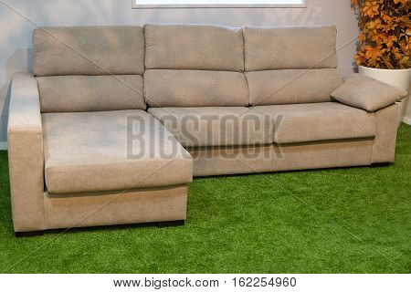 beige sofa with a chaise lounge in the living room