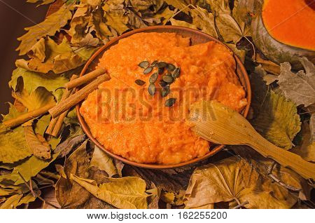 Pumpkin Soup In Rustic Bowl