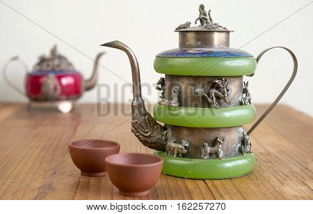 Vintage Chinese teapot made of old jade and Tibet silver with monkey lid