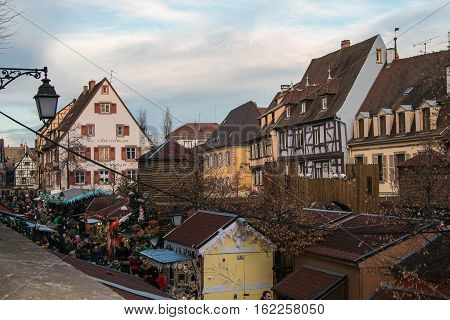 COLMAR, FRANCE - DECEMBER 9, 2016: Traditional christmas market on the historic center of Colmar in Alsace, France