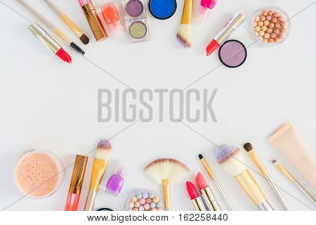 Colorful make up flat lay scene with copy space