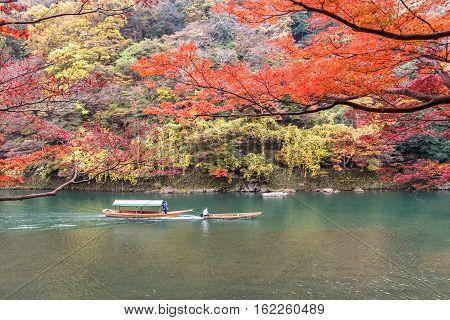 Sailing boat in autumn Arashiyama Kyoto Japan