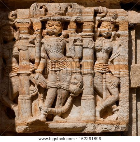 CHITTORGARH, INDIA - FEB 15, 2015: Fragment of monumental facade of traditional Hindu stone temple with stone artwork on February 15, 2015. Chitaurgarh has population 117000 and largest fort in Rajasthan