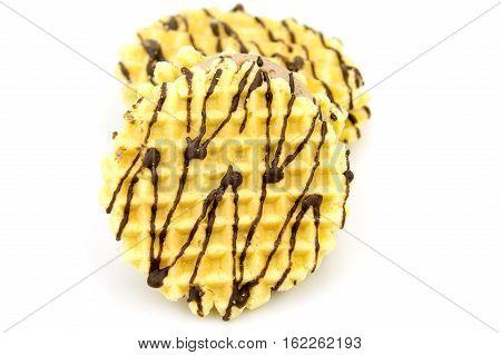 Vanilla wafers chocolate snack on white background.