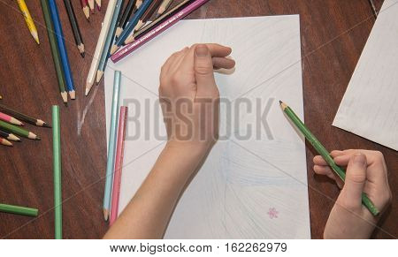 Children Draw With Colored Pencils.
