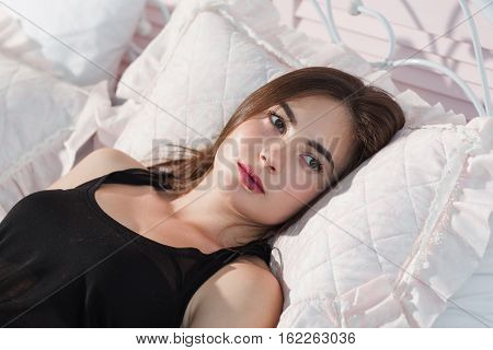 Young woman cant got sleeping in bed closeup. Beautiful lady lying on pillow with opened eyes, thinking about something. Insomnia, worry, fear concept
