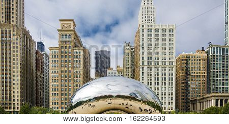 Chicago, IL, USA, october 27, 2016: Cloud Gate in Millennium Park in Chicago. The Cloud Gate is a major tourist attraction and a gate to traditional Chicago Jazz Fest.