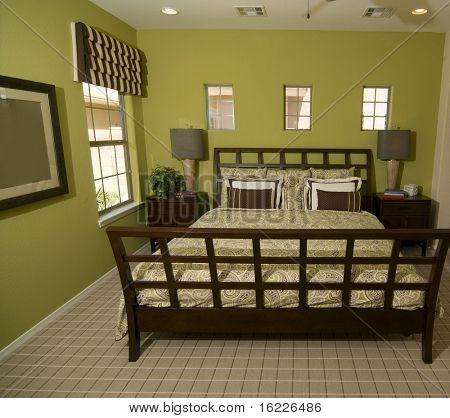 Beautiful wooden bed frame in bright green colored room