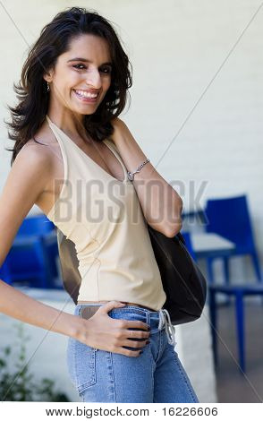 Attractive friendly smiling young Indian woman