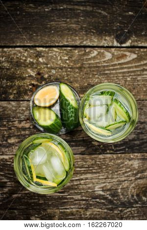 Detox water with cucumber and lemon . Top view. Space for text.