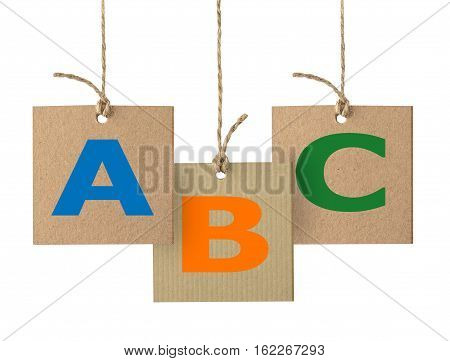 ABC letters on cardboard label with rope, alphabet logo design isolated on white.