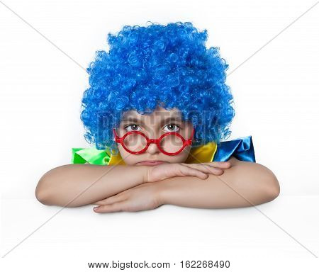 Sad girl in the blue wig with glasses on his nose on white background