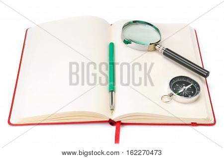 Notebook magnifying glass and compass isolated on white background