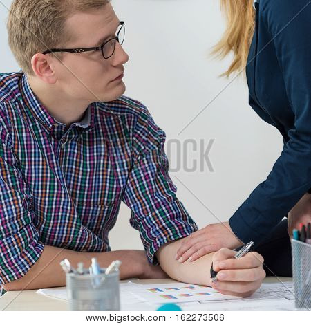 Close-up of woman supporting his worried co-worker