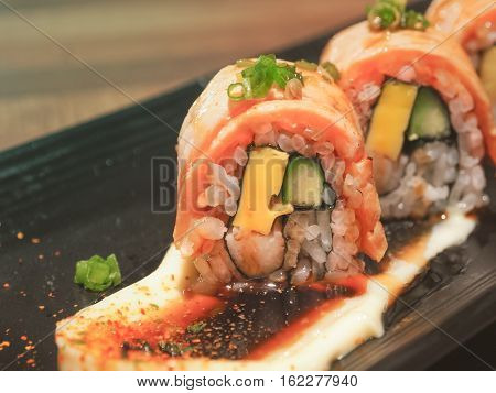 Salmon sushi roll maki ,Japanese cuisine, Close up and selective focus