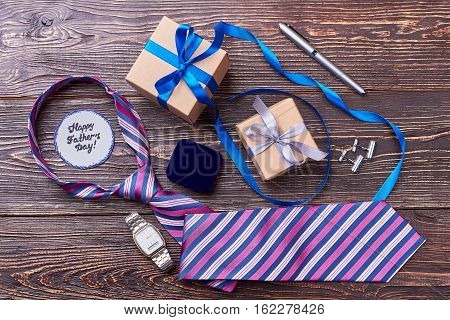 Accessories near Father's Day card. Pen, cufflinks and watch. Make daddy stylish.