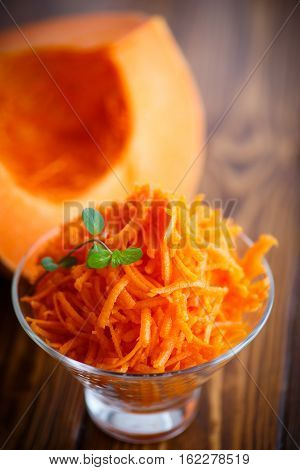 fresh grated sweet pumpkin with a sprig of mint