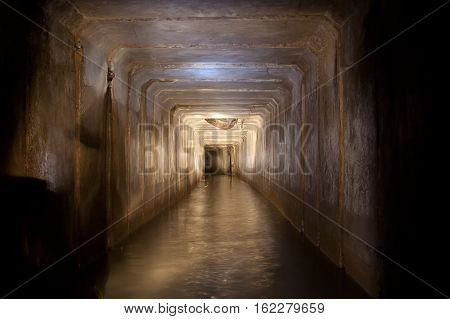 Flooded sewer tunnel with dirty polluted water of underground river under Voronezh