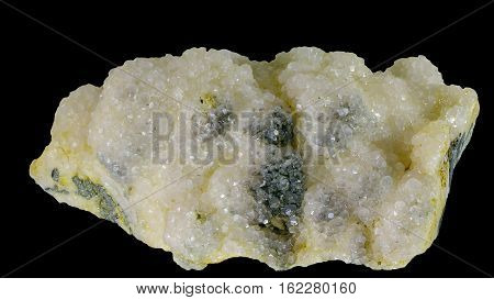 Natural raw Calcite crystal isolated on black
