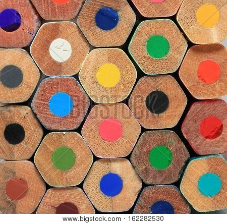 background of wooden pencils with colored leads