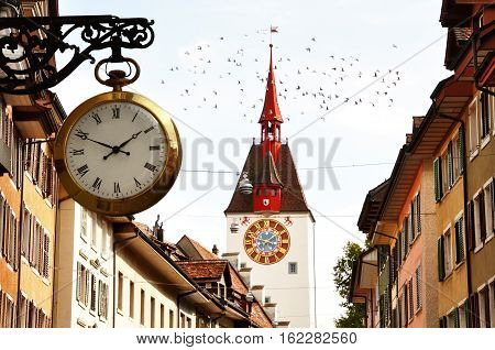 Characteristic clock and tower bell in Bremgarten old town canton Aargau Switzerland