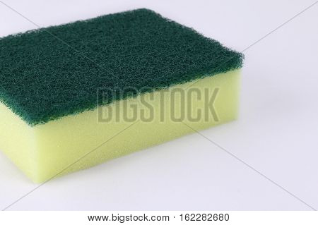 Scotch brite or dish washing sponge on white background.