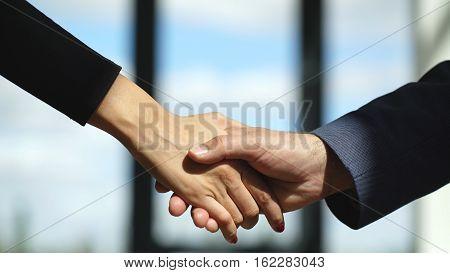 Business partnership meeting concept. Image businessmans handshake. Successful businessmen handshaking after good deal