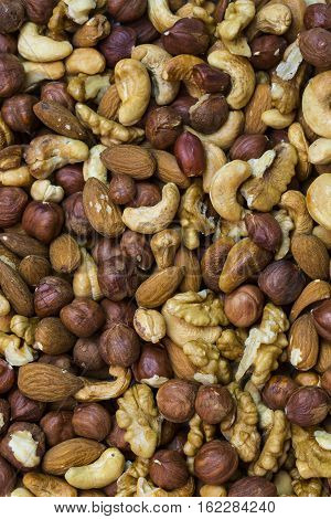 Background mix of nuts and raisins shot close-up