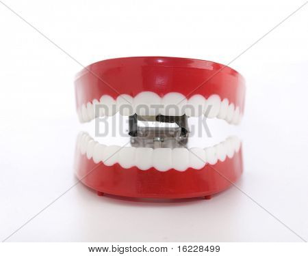 Smiling kitsch joke wind up chattering teeth and mouth