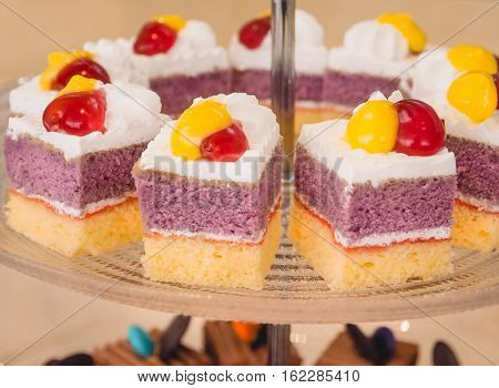 Mini cake with strawberry jelly on glass tray for party event, Pastel and soft  filter color