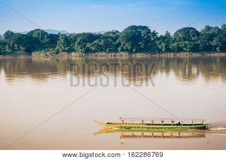 long-tailed boat on river at countryside Chiang Kan Thailand.