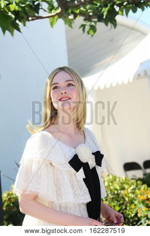 Elle Fanning attends the 'The Neon Demon' photocall during the 69th annual Cannes Film Festival at Palais des Festivals on May 20, 2016 in Cannes, France.